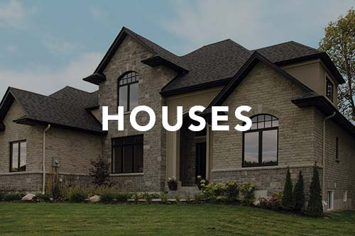 Upscale stone and brick house, link to houses photo gallery