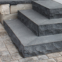 Dark Chiselled Limestone Steps at the front of a house.