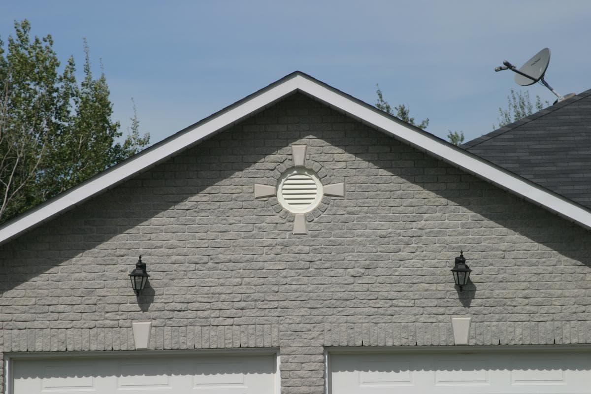 Round Vent Above Garage Doors With Keystones