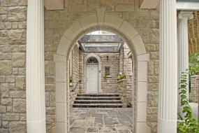 Shouldice Designer Stone - Arch and door with Roman surrounds
