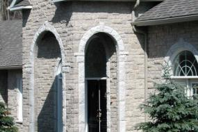 Shouldice Designer Stone - Arches and door with Roman surround