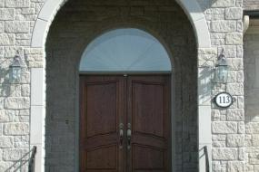 Shouldice Designer Stone - Arch and door with Roman surround