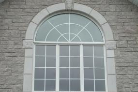 Shouldice Designer Stone - Window with Roman surround and keystone