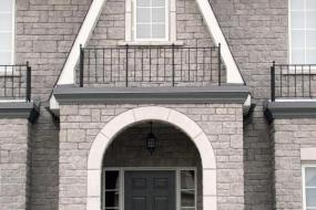 Shouldice Designer Stone - Arch and window with Roman surrounds