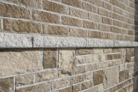 Sill separating brick and stone